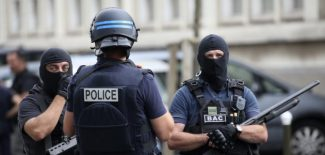 French police and anti-crime brigade secure a street as members of special forces carried out counter-terrorism swoop at different locations in Argenteuil, a suburb in northern Paris